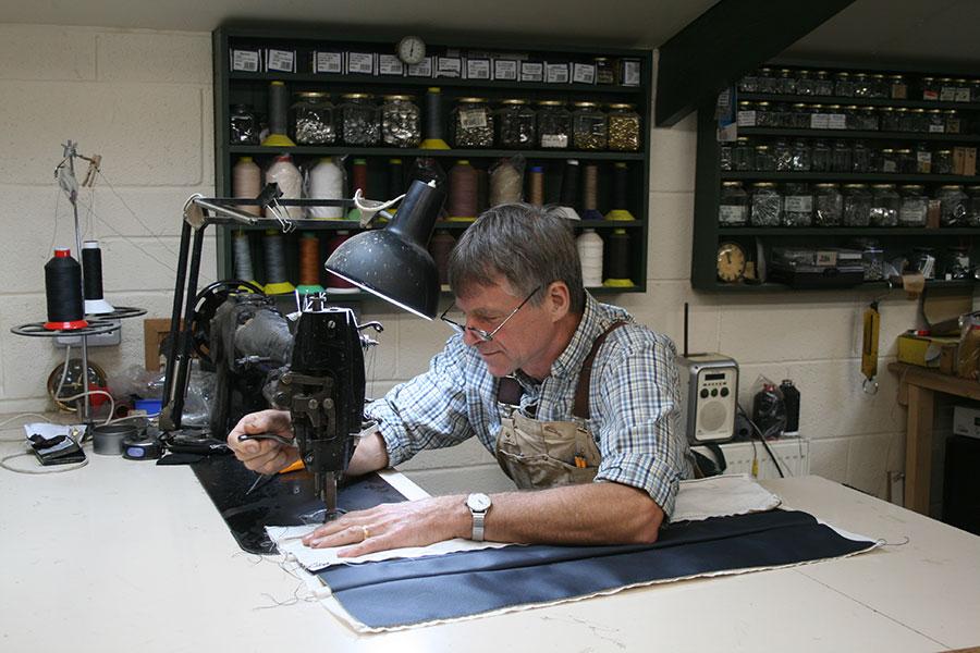 David Nightingale working at a machine in his workshop